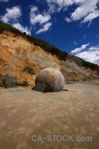 Round rock cliff boulder sky.