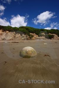 Sand beach new zealand rock moeraki boulders.