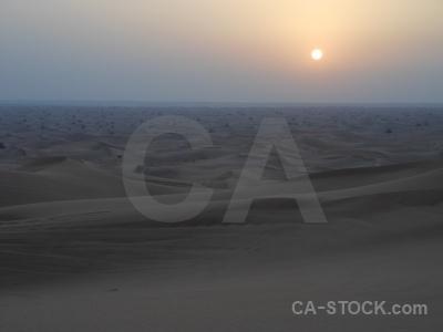 Sand sky dune sun uae.