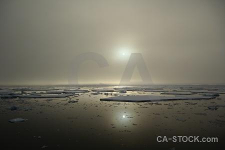 Sea antarctica snow cloud reflection.