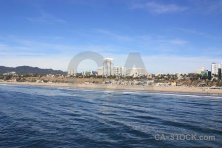 Sea building beach cityscape water.