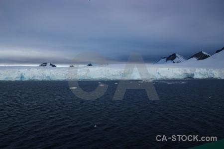 Sea cloud mountain landscape south pole.