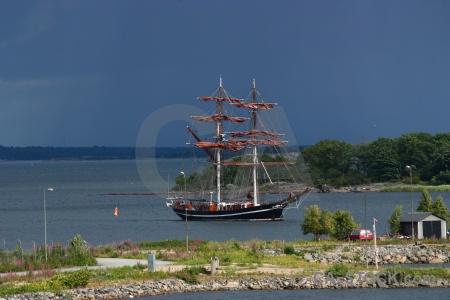 Sea grass sail sky boat.