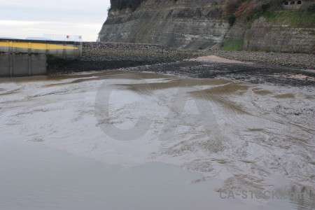 Sea gray beach water mud.