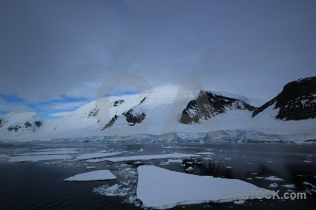 Sea ice gunnel channel antarctic peninsula mountain snow.