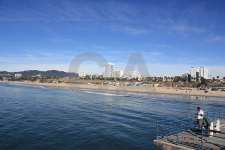 Sea person cityscape water beach.