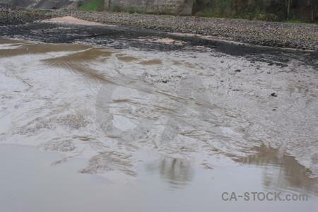 Sea water gray beach mud.