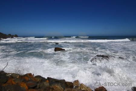Sea water sky rock beach.