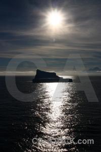Silhouette sunrise antarctica cruise antarctic peninsula iceberg.