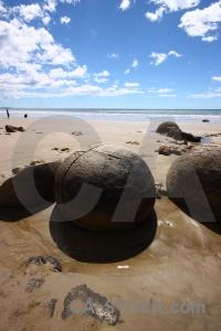 Sky beach rock sand cloud.