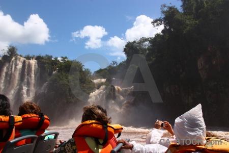 Sky iguacu falls river speedboat spray.