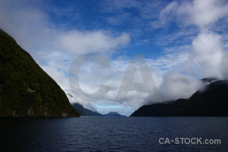 Sky mountain fiord fiordland south island.