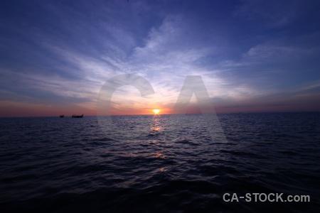Sky phi island reflection boat cloud.