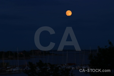 Sky sea vehicle tree moon.