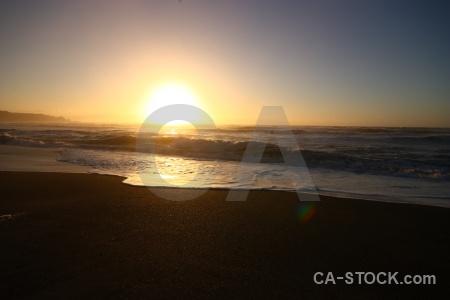 Sky south island sunset beach wave.