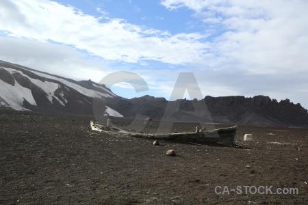 Sky volcano boat wreck sand.