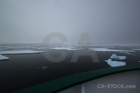 Snow ice fog water antarctica cruise.