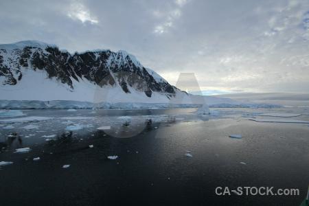 Snow sea cloud ice south pole.