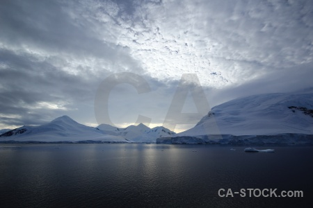 Snowcap antarctic peninsula cloud antarctica cruise sky.