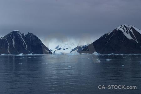 Snowcap iceberg antarctic peninsula bellingshausen sea water.