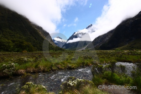Snowcap mountain water hollyford river rock.
