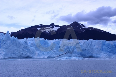 Snowcap terminus glacier ice sky.