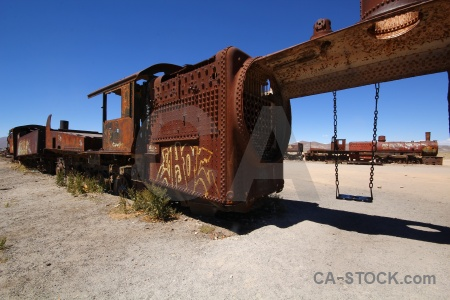 South america train rust vehicle sky.
