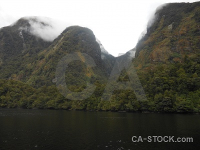 South island fiord cloud mountain doubtful sound.