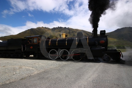South island steam carriage mountain smoke.