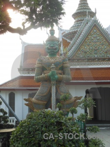 Southeast asia buddhist yaksha statue tree.