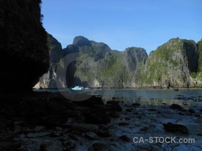 Southeast asia ko phi ley boat island cliff.