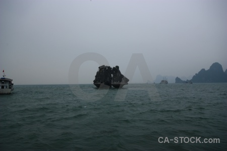 Southeast asia mountain boat island ha long bay.