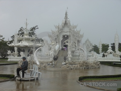 Southeast asia ornate tree person white temple.