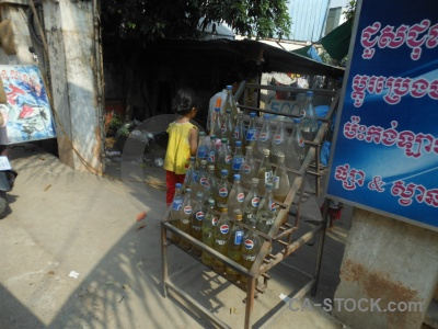 Southeast asia person petrol phnom penh bottle.