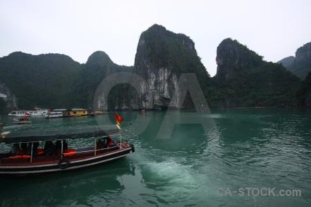 Southeast asia unesco vietnam cliff boat.