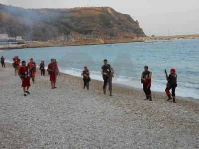 Spain fiesta costume musket sea.