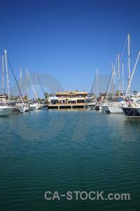 Spain harbour blue sea vehicle.