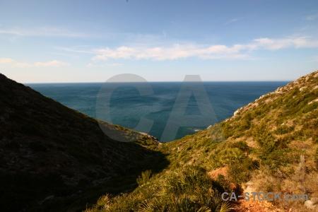 Spain sea cloud water bush.