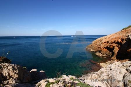 Spain sky rock europe water.