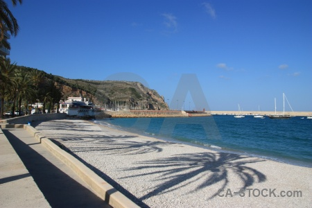 Spain stone cloud shadow beach.