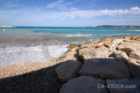 Spain water sky stone beach.