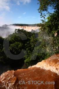 Spray waterfall iguazu river argentina sky.