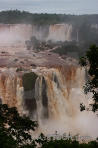 Spray waterfall river water iguazu.