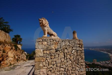 Statue lion wall spain javea.