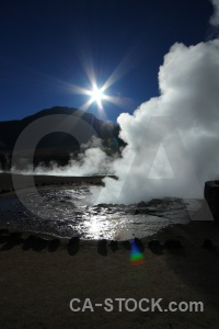 Steam geyser el tatio chile sun.