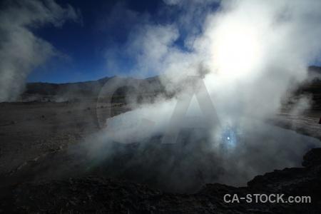 Steam mountain geyser atacama desert sun.