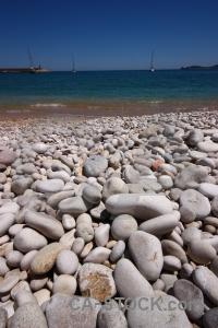 Stone beach spain europe sky.