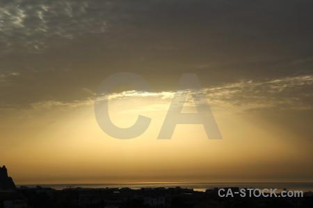Sunrise golden sunset coast overcast.