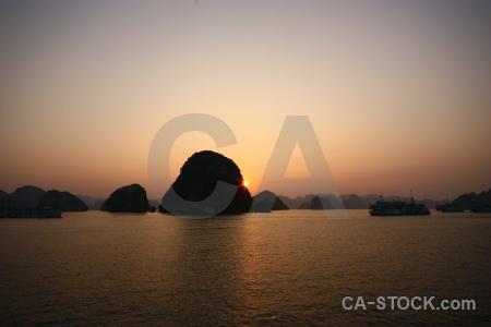 Sunrise island silhouette limestone sea.