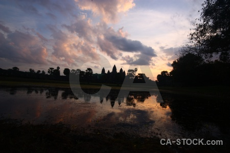 Sunrise sunset silhouette water angkor wat.